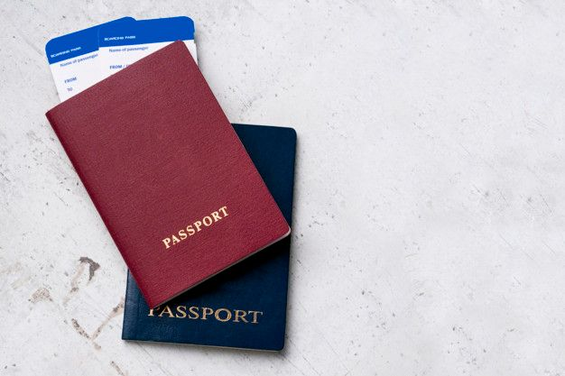 two-travelers-passports-red-blue-with-boarding-passes-plane_100894-47